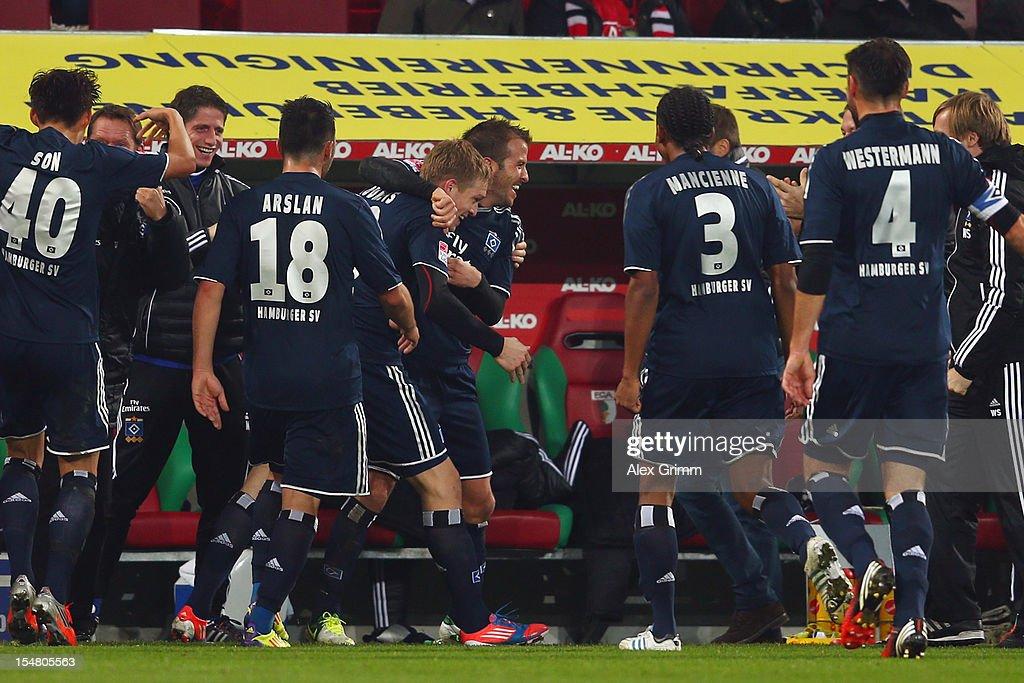 Artjoms Rudnevs (C) of Hamburg celebrates his team's second goal with Rafael van der Vaart and team mates during the Bundesliga match between FC Augsburg and Hamburger SV at SGL Arena on October 26, 2012 in Augsburg, Germany.