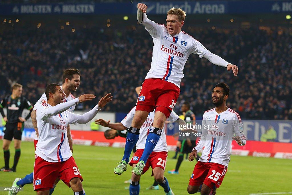 Artjoms Rudnevs of Hamburg celebrates scoring the opening goal with his team mates during the Bundesliga match between Hamburger SV and SV Werder Bremen at Imtech Arena on November 23, 2014 in Hamburg, Germany.