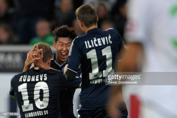 Artjoms Rudnevs of Hamburg celebrates with teammate Heung Min Son after scoring his team's second goal during the Bundesliga match between Borussia...