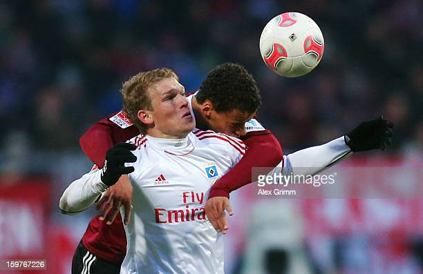 Artjoms Rudnevs of Hamburg is challenged by Timothy Chandler of Nuernberg during the Bundesliga match between 1. FC Nuernberg and Hamburger SV at...