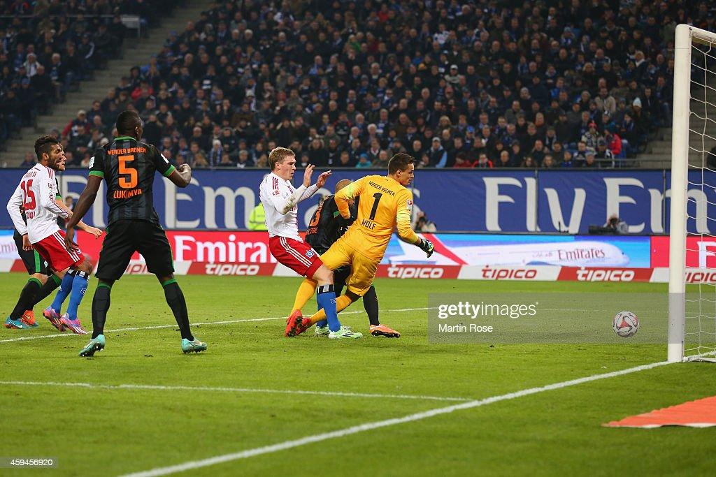 Artjoms Rudnevs of Hamburg scores the opening goal against Raphael Wolf, keeper of Bremen during the Bundesliga match between Hamburger SV and SV Werder Bremen at Imtech Arena on November 23, 2014 in Hamburg, Germany.