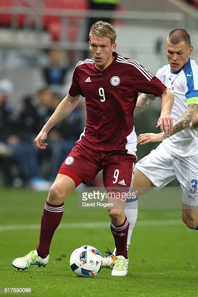 Artjoms Rudnevs of Latvia runs with the ball during the international friendly match between Slovakia and Latvia held at Stadion Antona Malatinskeho...