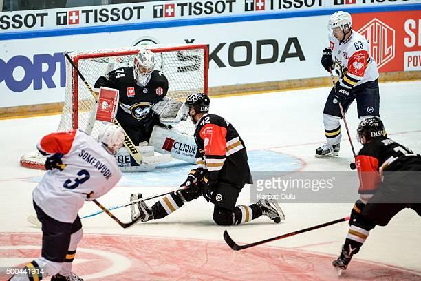 Arto Laatikainen of Karpat Oulu defending a shot from Eero Somervuori of Espoo Blues during the Champions Hockey League quarter final between Karpat...