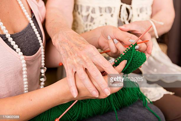Arts Crafts: Senior Woman shows Young Adult how to knit