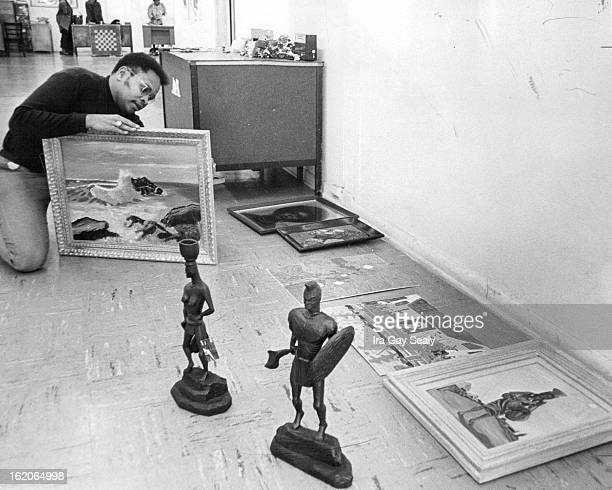 NOV 28 1969 Arts Crafts Show And Sale Begins Artist Bob Ragland prepares an oil seas cape by Charles Dabney 3319 Krameria St and a wood carving of an...