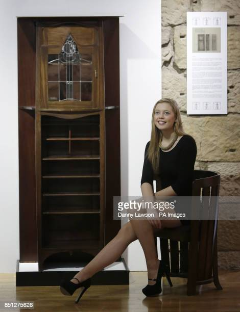 Arts graduate Charlotte Roberts is pictured with a long lost music cabinet designed by Charles Rennie Mackintosh at The Lighthouse in Glasgow Scotland