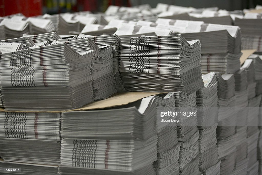Arts sections of the Washington Post sit stacked before being bundled at the Post's newspaper production facility in Springfield, Virginia, U.S., on Friday, July 12, 2013. The Washington Post began publishing on Thursday, Dec. 6, 1877, and had a circulation of 10,000. The newspaper contained four pages and cost three cents a copy. Photographer: Andrew Harrer/Bloomberg via Getty Images