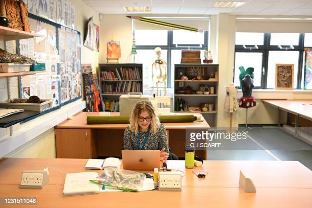 Arts teacher Sophie Parkinson conducts an online class from an empty classroom at Park Lane Academy in Halifax, northwest England on March 4, 2021. -...