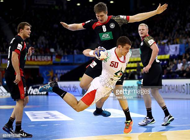 Artsem Karalek of Belarus challenges Finn Lemke of Germany during the 25th IHF Men's World Championship 2017 match between Belarus and Germany at...