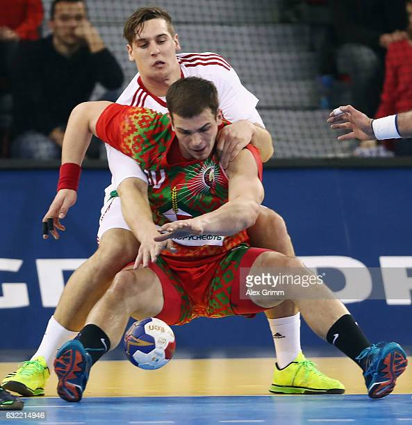 Artsem Karalek of Belarus is challenged by Patrik Ligetvari of Hungary during the 25th IHF Men's World Championship 2017 match between Belarus and...