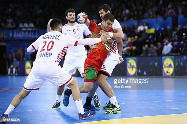 Artsem Karalek of Belarus is challenged by Tin Kontrec Domagoj Dunjak and Luka Sebetic of Croatia during the 25th IHF Men's World Championship 2017...