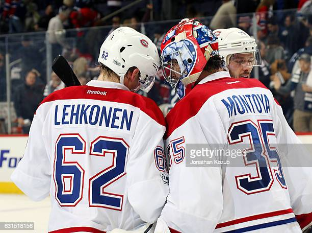 Artturi Lehkonen and goaltender Al Montoya of the Montreal Canadiens celebrate a 74 victory over the Winnipeg Jets at the MTS Centre on January 11...