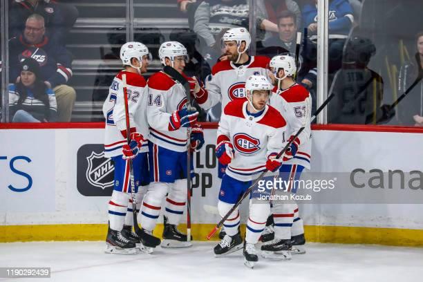 Artturi Lehkonen Nick Suzuki Shea Weber Max Domi and Victor Mete of the Montreal Canadiens celebrate a second period goal against the Winnipeg Jets...