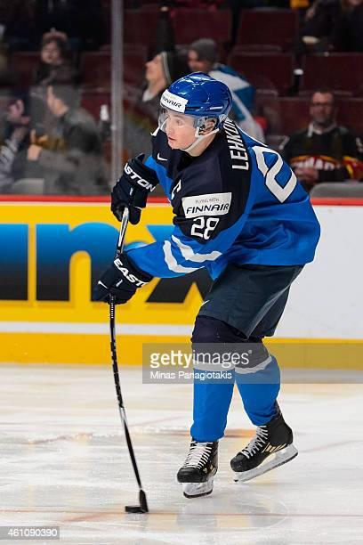 Artturi Lehkonen of Team Finland passes the puck in a preliminary round game during the 2015 IIHF World Junior Hockey Championships against Team...