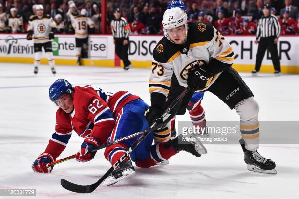 Artturi Lehkonen of the Montreal Canadiens and Charlie McAvoy of the Boston Bruins battle for position during the third period at the Bell Centre on...