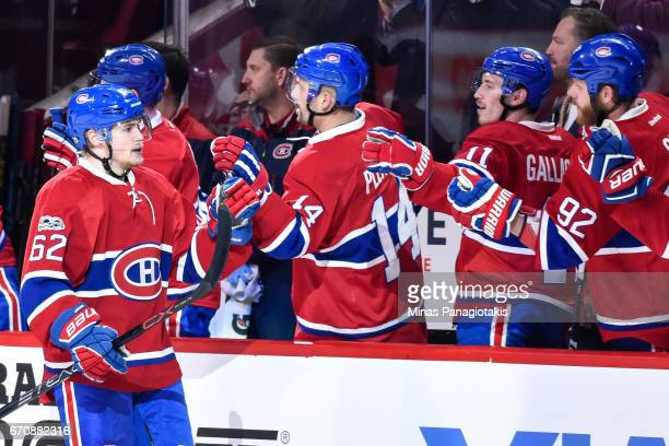 Artturi Lehkonen of the Montreal Canadiens celebrates a first period goal with teammates on the bench against the New York Rangers in Game Five of...