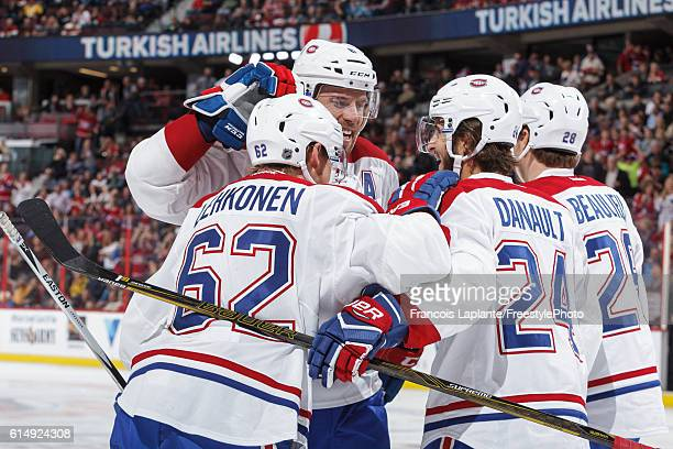 Artturi Lehkonen of the Montreal Canadiens celebrates his first NHL goal with teammates Shea Weber Phillip Danault and Nathan Beaulieu during an NHL...