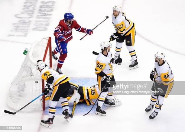 Artturi Lehkonen of the Montreal Canadiens celebrates his goal as Tristan JarryJustin SchultzKris LetangTeddy Blueger and Zach AstonReese of the...