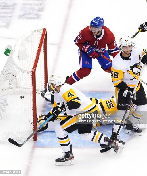 Artturi Lehkonen of the Montreal Canadiens celebrates his goal as Tristan Jarry,Justin Schultz and Kris Letang of the Pittsburgh Penguins look on in...