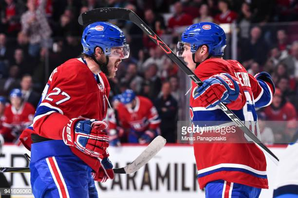 Artturi Lehkonen of the Montreal Canadiens celebrates his second period goal with teammate Alex Galchenyuk against the Winnipeg Jets during the NHL...