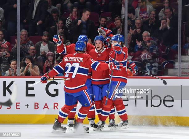 Artturi Lehkonen of the Montreal Canadiens celebrates with teammates after scoring a goal against the Dallas Stars in the NHL game at the Bell Centre...