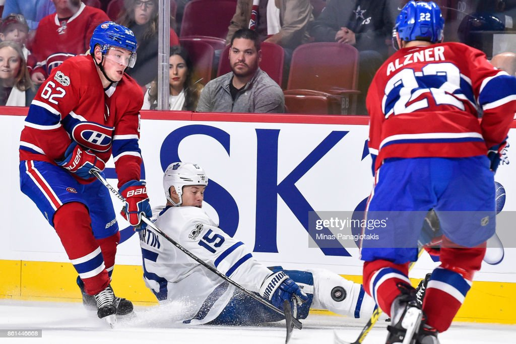 Artturi Lehkonen #62 of the Montreal Canadiens challenges Matt Martin #15 of the Toronto Maple Leafs during the NHL game at the Bell Centre on October 14, 2017 in Montreal, Quebec, Canada. The Toronto Maple Leafs defeated the Montreal Canadiens 4-3 in overtime.