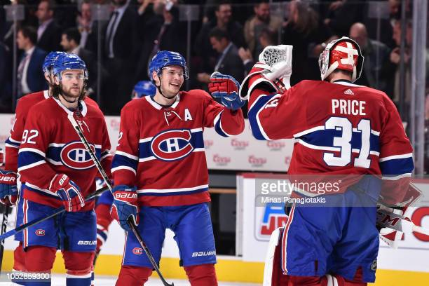 Artturi Lehkonen of the Montreal Canadiens congratulates goaltender Carey Price on a win against the Calgary Flames at the Bell Centre on October 23...