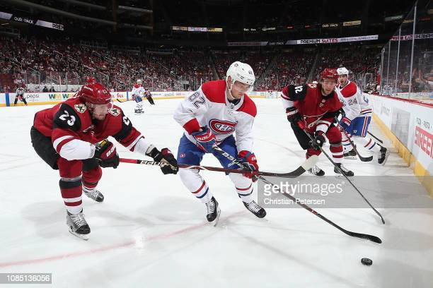 Artturi Lehkonen of the Montreal Canadiens controls the puck under pressure from Oliver EkmanLarsson of the Arizona Coyotes during the second period...