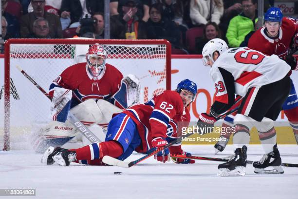 Artturi Lehkonen of the Montreal Canadiens falls to block a shot by Tyler Ennis of the Ottawa Senators during the second period at the Bell Centre on...