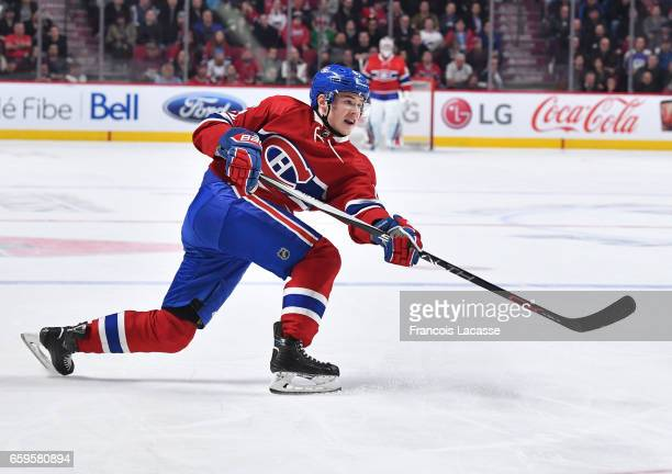 Artturi Lehkonen of the Montreal Canadiens fires a shot against the Dallas Stars in the NHL game at the Bell Centre on March 28 2017 in Montreal...