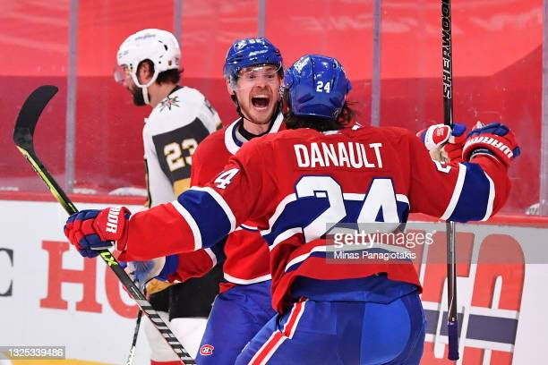 Artturi Lehkonen of the Montreal Canadiens is congratulated by Phillip Danault after scoring the game-winning goal during the first overtime period...