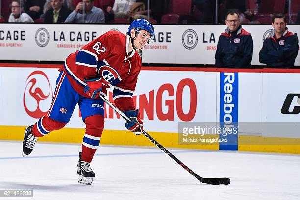 Artturi Lehkonen of the Montreal Canadiens prepares to shoot the puck during the warmup prior to the NHL game against the Vancouver Canucks at the...