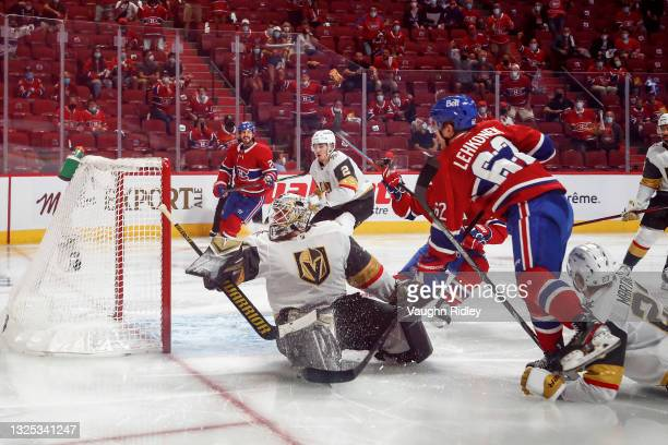 Artturi Lehkonen of the Montreal Canadiens scores the game-winning goal past Robin Lehner of the Vegas Golden Knights during the first overtime...