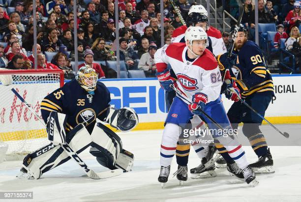 Artturi Lehkonen of the Montreal Canadiens screens Linus Ullmark of the Buffalo Sabres during an NHL game on March 23 2018 at KeyBank Center in...