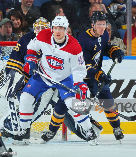 Artturi Lehkonen of the Montreal Canadiens sets up a screen in front of Linus Ullmark and Casey Nelson of the Buffalo Sabres during an NHL game on...