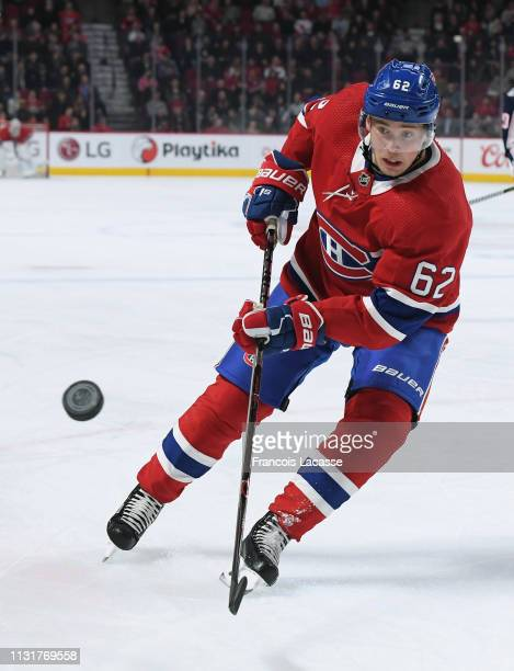 Artturi Lehkonen of the Montreal Canadiens skates for the puck against the Columbus Blue Jackets in the NHL game at the Bell Centre on February 19...