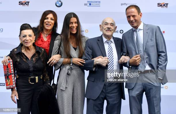 Artur 'Atze' Brauner German film producer of Polish descent poses with his wife Maria his daughters Alice and Laura and his son Sammy at the...