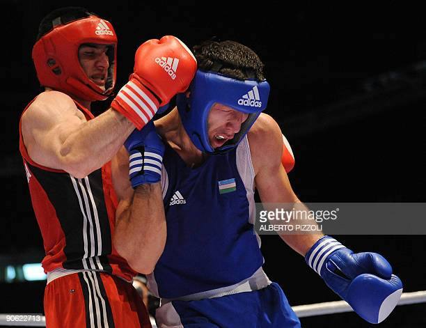 Artur Beterbiev of Russia and Elshod Rasulov of Uzbekistan compete during their lightheavyweight final at the AIBA World Boxing Cup in Assago Forum...
