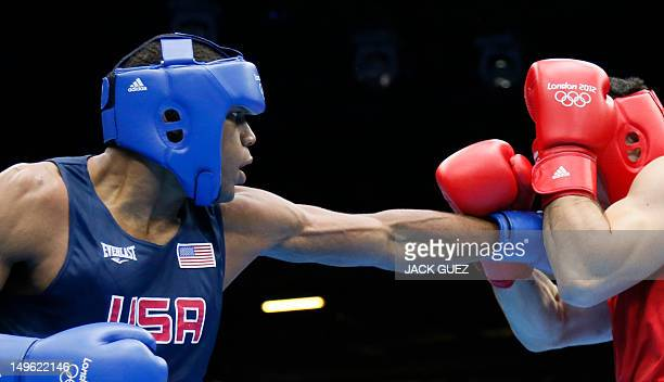 Artur Beterbiev of Russia defends against Michael Hunter Ii of the USA during their round of 16 Heavyweight boxing match of the London 2012 Olympics...