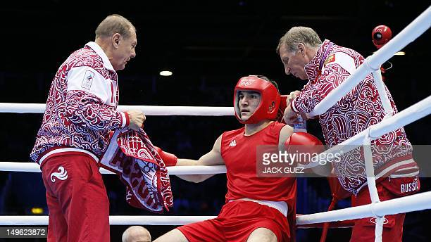 Artur Beterbiev of Russia speaks with his corner betwen rounds against Michael Hunter Ii of the USA during their round of 16 Heavyweight boxing match...