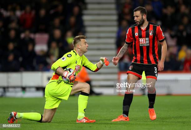 Artur Boruc of AFC Bournemouth and Steve Cook of AFC Bournemouth embrace during the Premier League match between AFC Bournemouth and Swansea City at...
