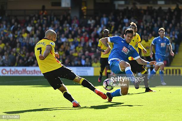 Artur Boruc of AFC Bournemouth attempts to block Nordin Amrabat of Watford shot during the Premier League match between Watford and AFC Bournemouth...
