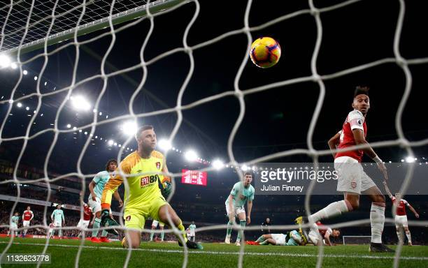 Artur Boruc of AFC Bournemouth attempts to save the ball as Laurent Koscielny of Arsenal scores his team's third goal during the Premier League match...