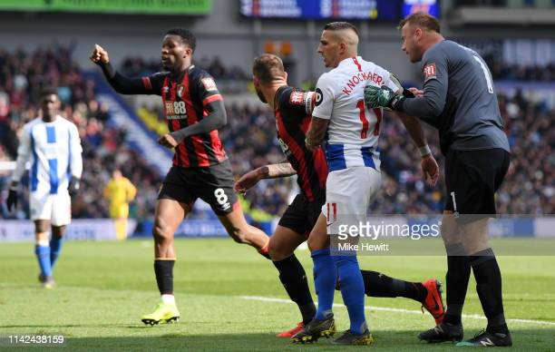 Artur Boruc of AFC Bournemouth clashes with Anthony Knockaert of Brighton and Hove Albion after a foul during the Premier League match between...