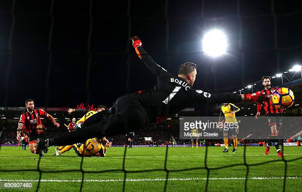 Artur Boruc of AFC Bournemouth dives in vain as Olivier Giroud of Arsenal scores his team's third goal during the Premier League match between AFC...