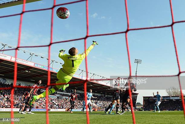 Artur Boruc of Bournemouth dives in vain as Kevin de Bruyne of Manchester City scores his team's first goal during the Barclays Premier League match...