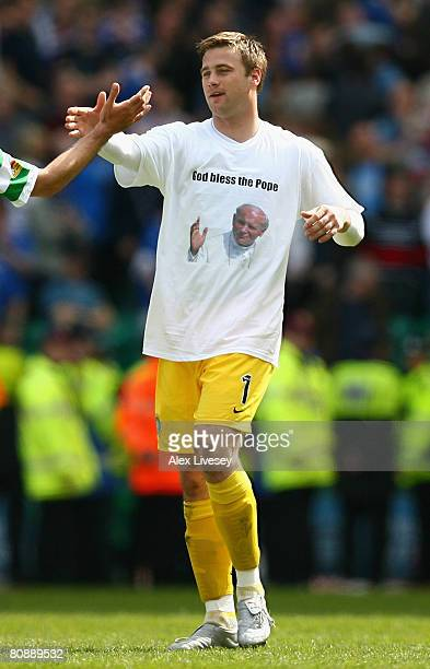 Artur Boruc of Celtic wears a 'God bless the pope' tshirt as he celebrates with George Samaras after the Clydesdale Bank Scottish Premier League...