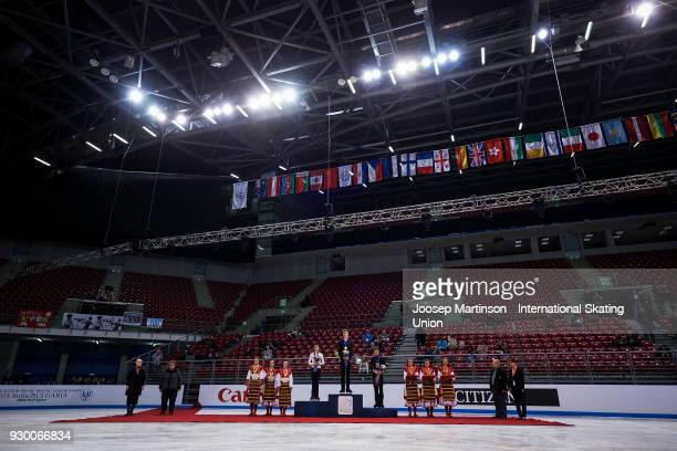Artur Danielian of Russia Alexey Erokhov of Russia and Matteo Rizzo of Italy pose in the Junior Men's medal ceremony during the World Junior Figure...
