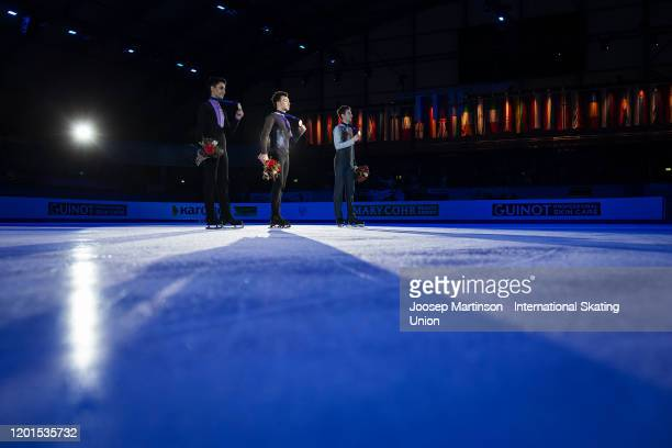Artur Danielian of Russia Dmitri Aliev of Russia and Morisi Kvitelashvili of Georgia pose in the Men's medal ceremony during day 2 of the ISU...