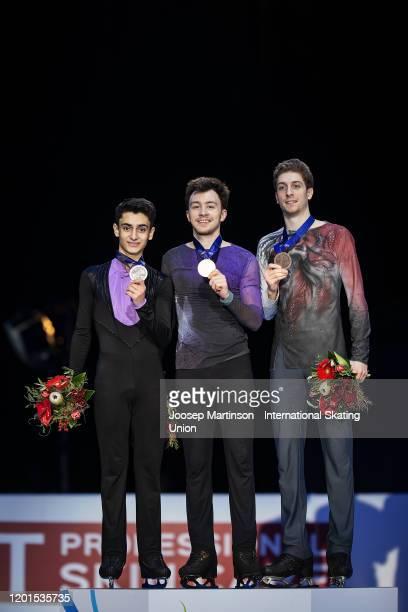 Artur Danielian of Russia Dmitri Aliev of Russia and Morisi Kvitelashvili of Georgia pose in the Men's medal ceremony during day 2 of the ISU...